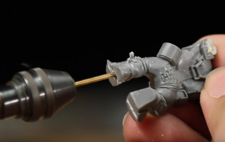 Drill a hole through the bottom of your miniature with a pin vise drill