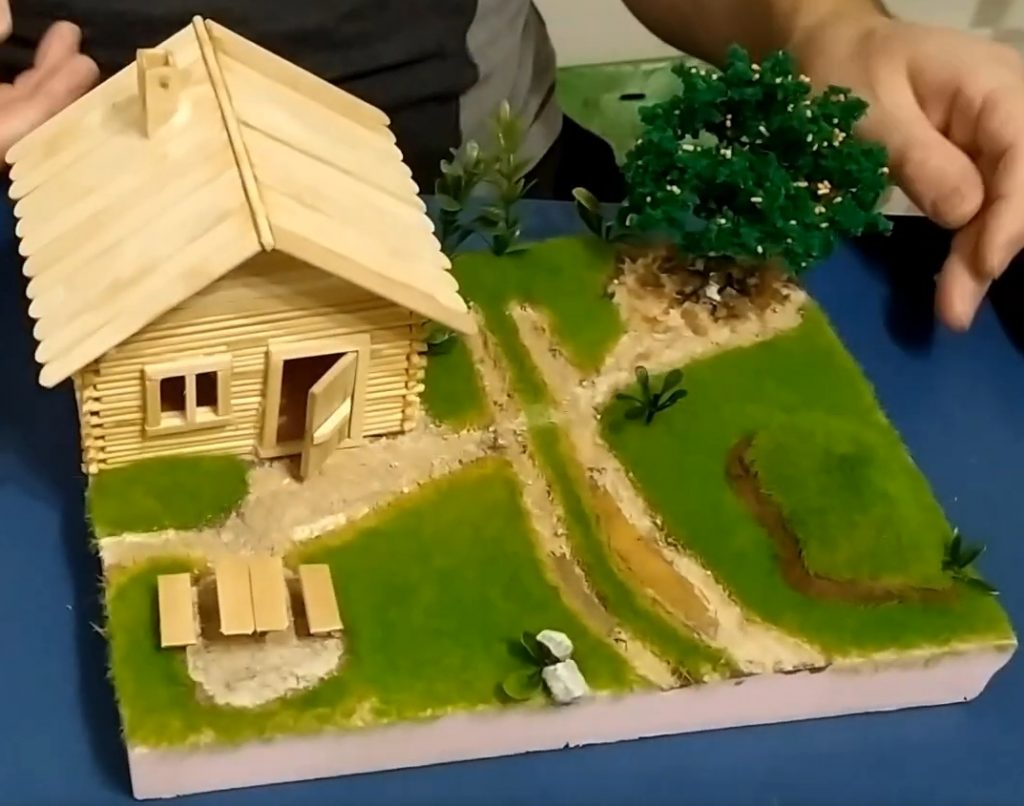 Step 9: Other things, such as stone, moss, bark, and wood, can be added to make your diorama more realistic